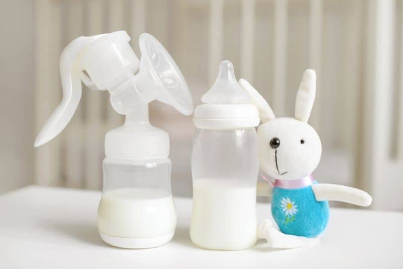 Breast pump and baby bottle on the table