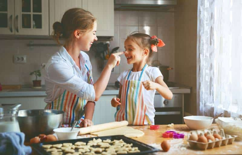 mother and child daughter baking