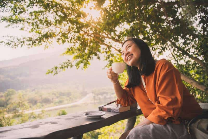 woman drinking coffee in morning with sunshine