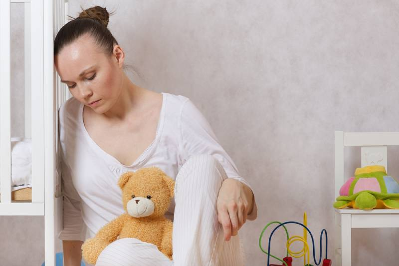 young mother experiencing postnatal depression