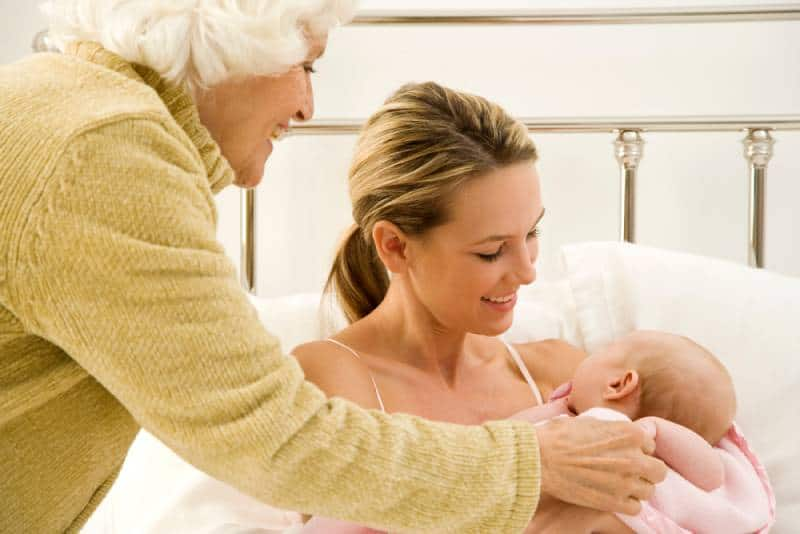 woman with her daughter and newborn grandchild