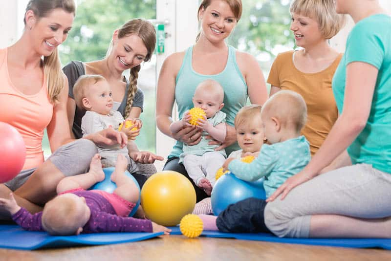 group of women at parenting class with babies