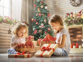 girls opening gifts on Christmas morning