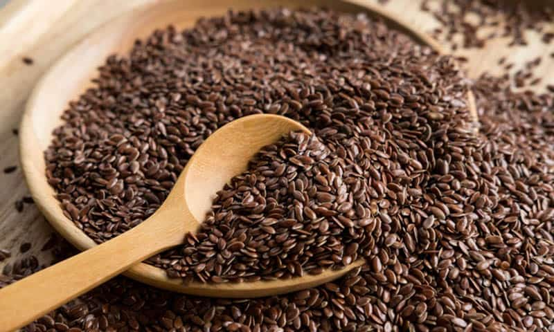 flaxseed in a bowl with a spoon