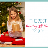 cute little girl holding a christmas gift