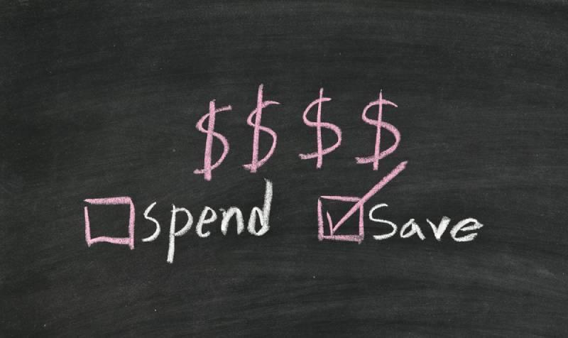 save money not spend written on blackboard