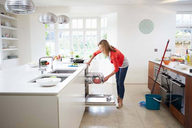 woman loading the dishwasher