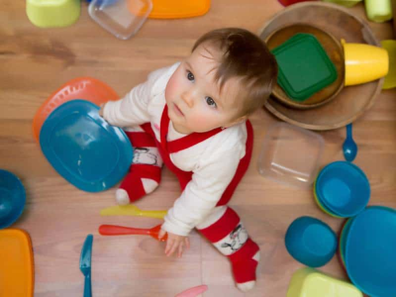 Baby playing with plastic containers