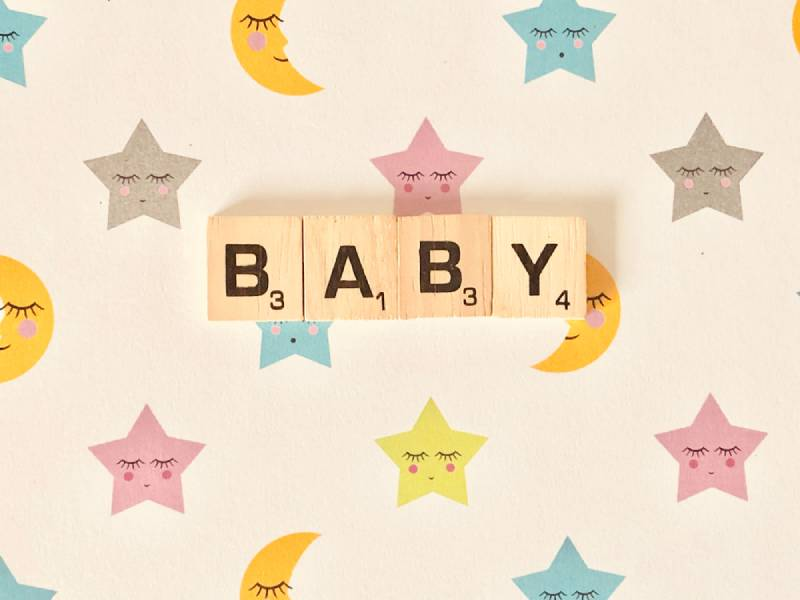 Baby with scrabble titles