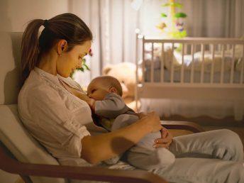 woman breast feeding baby