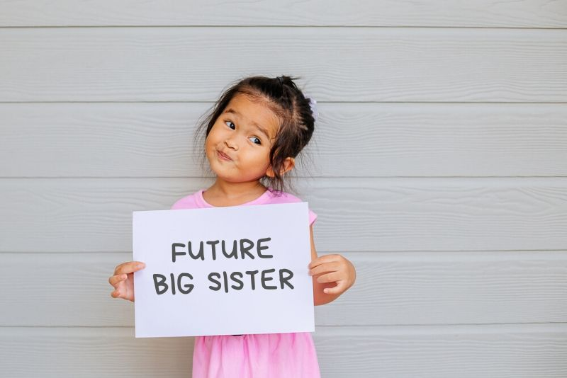 Girl holding Future Big Sister Sign