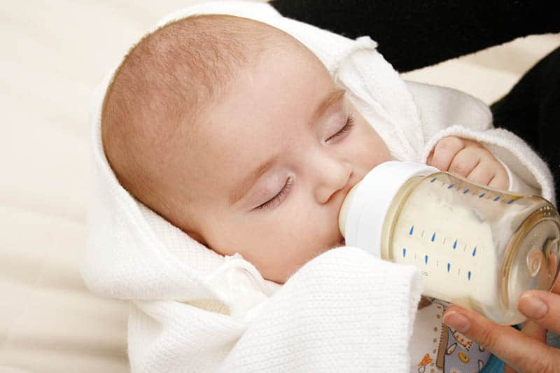How Much Does A Newborn Eat? Feeding FAQs Answered