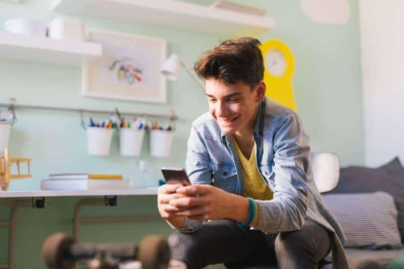 Teenage boy using his smartphone