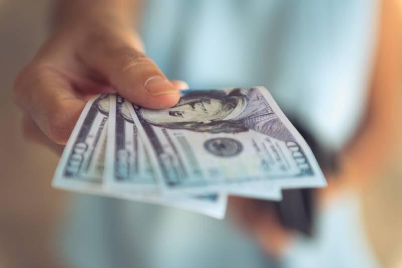 Woman holding dollar bills