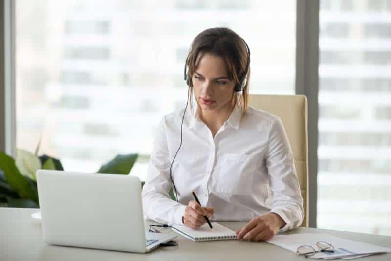 Woman watching online tutorial