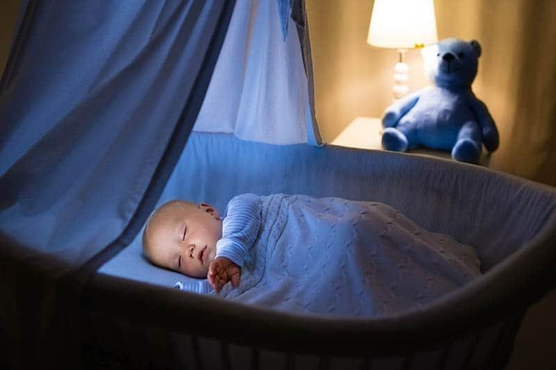baby sleeping in bassinet