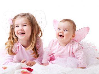 Little sisters wearing fairy wings