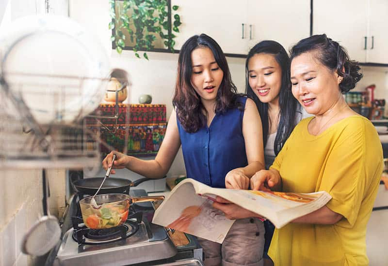 three women cooking with friends monthly meal plannera