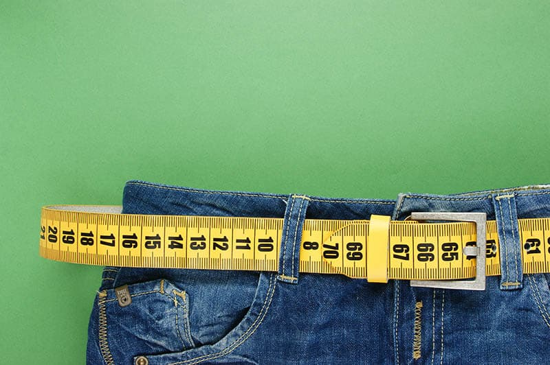 weight loss pants with measuring tape