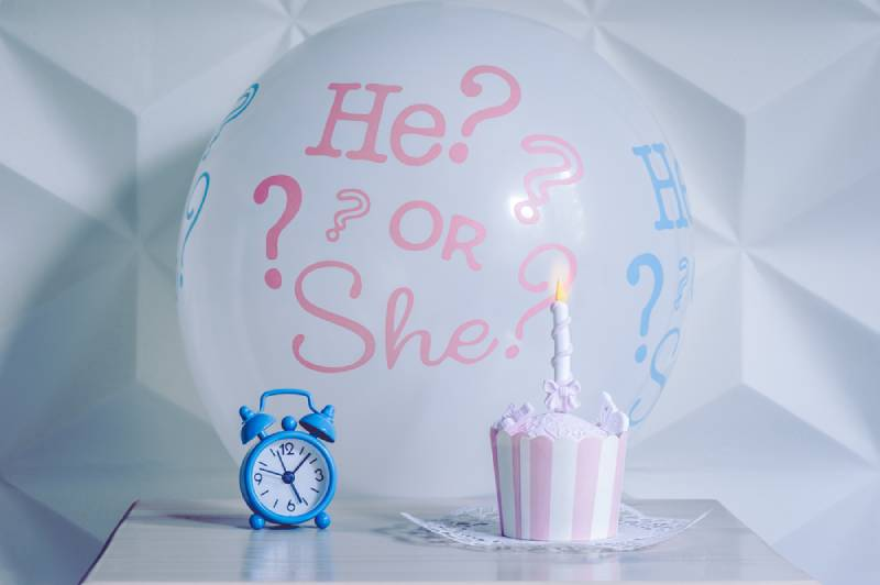 A balloon he or she from a gender reveal party