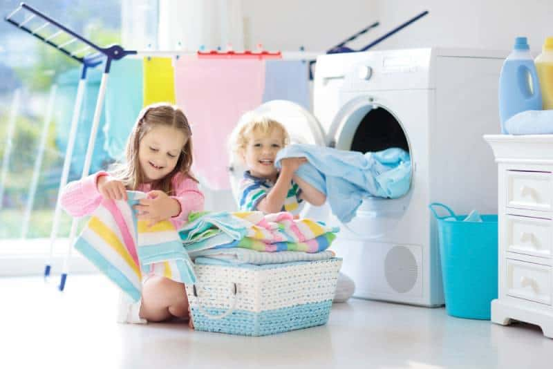 Children helping in laundry room