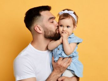 Father holding his baby daughter