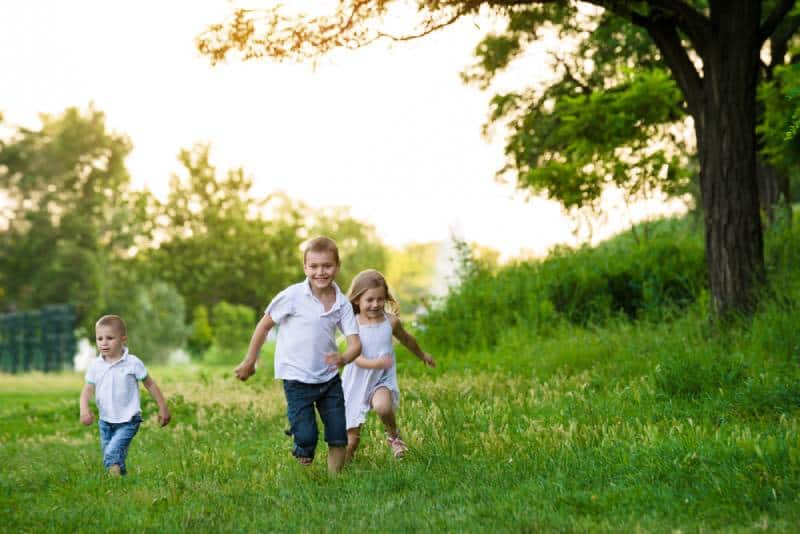 Kids running in the park with their friends