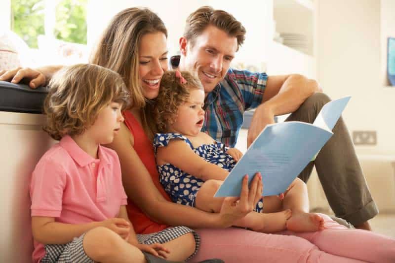 Parents Sitting With Children