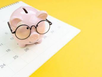 Piggy bank on a paper calendar