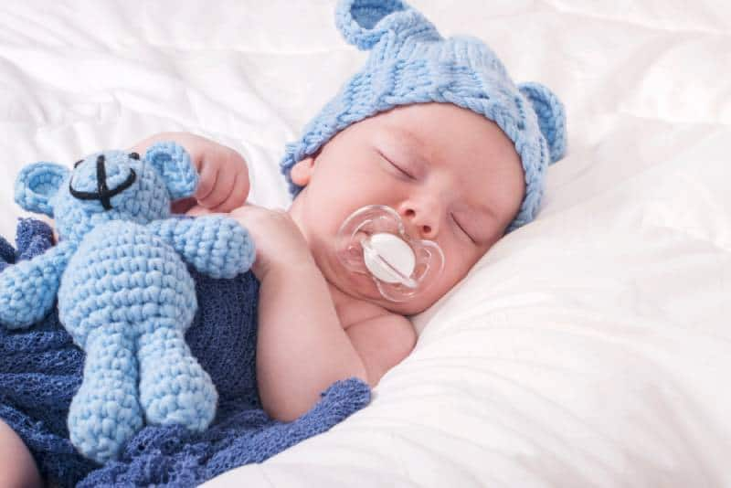 Sleeping baby boy with pacifier