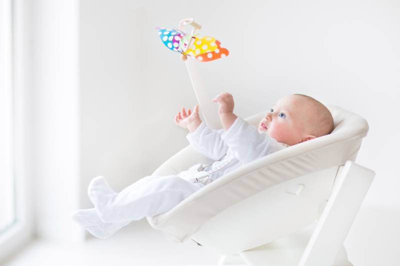 bbay boy playing in a white swing