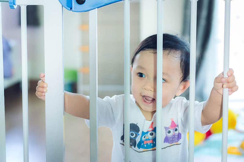 baby behind a baby gate