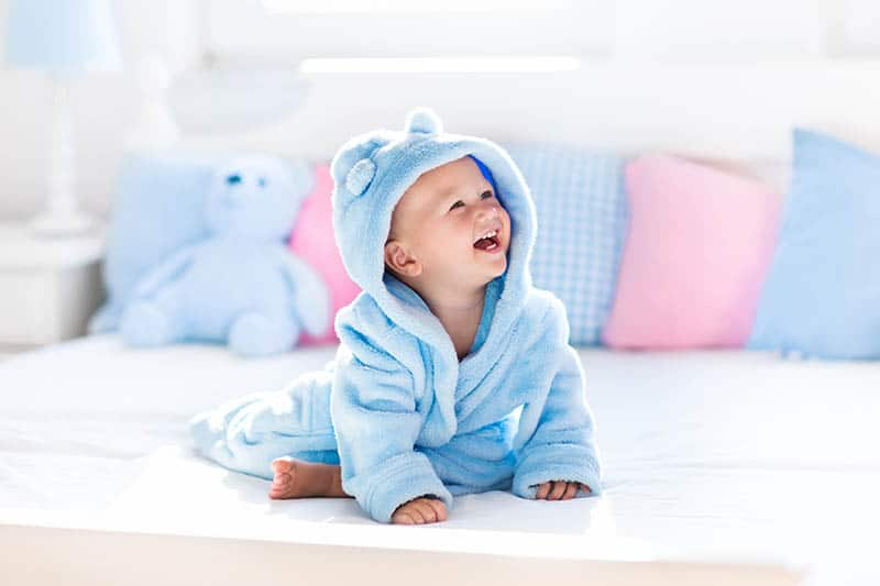 baby in blue washcloths