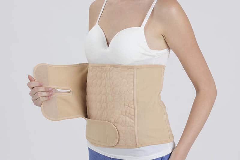 woman with c section recovery belt