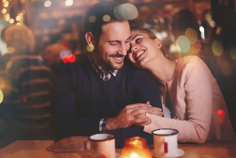 happy couple in a restaurant enjoying