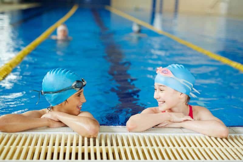 kids smiling in swimming pool