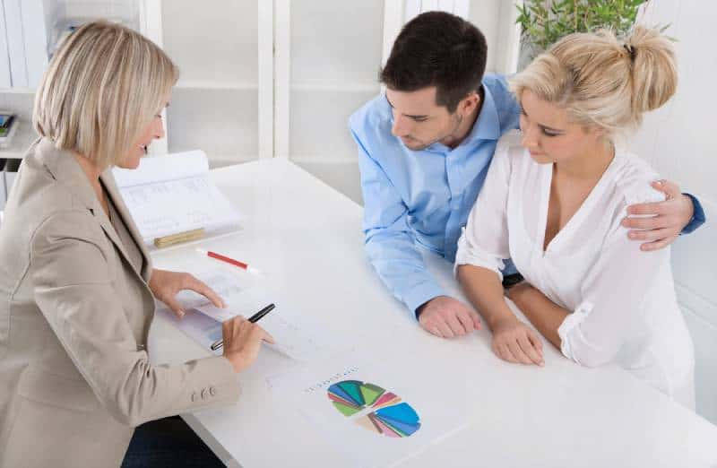 Young couple on a meeting with credit counselor