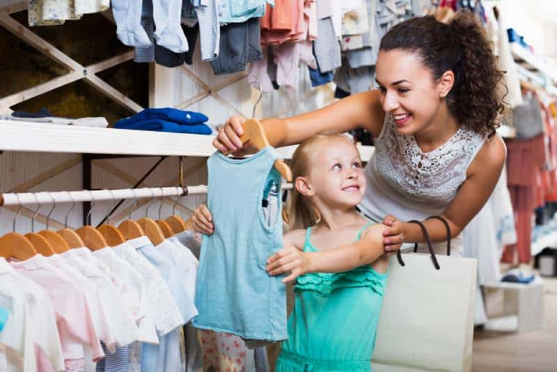 mother with daughter buying clothes