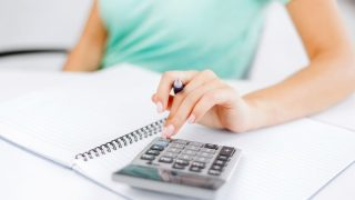 woman organizing her bills