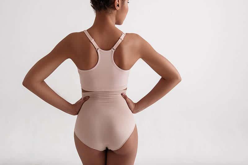 woman in High Waist Underwear from back