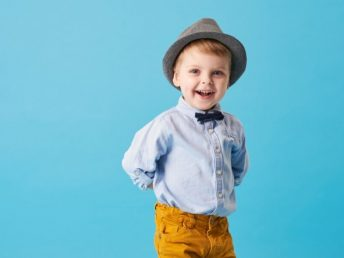 Cute little boy wearing a bow tie and smiling