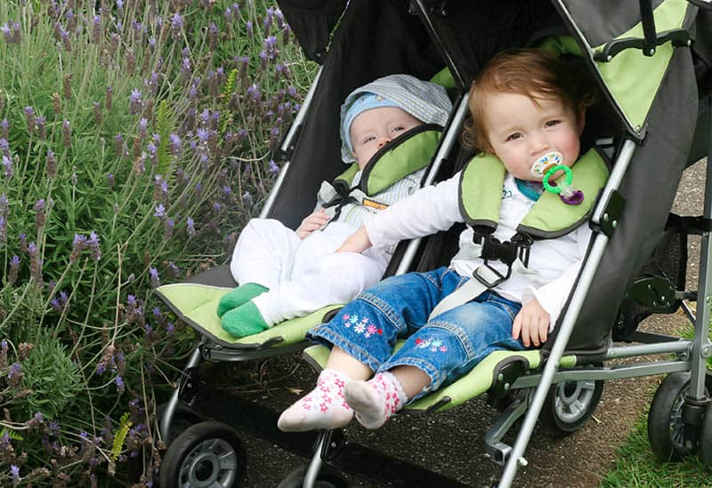 babies in green double stroller
