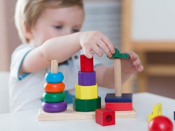 baby playing with Toys For Fine Motor Skills