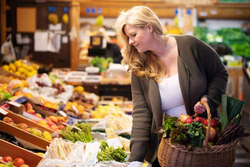 Woman is shopping fresh fruits and vegetables