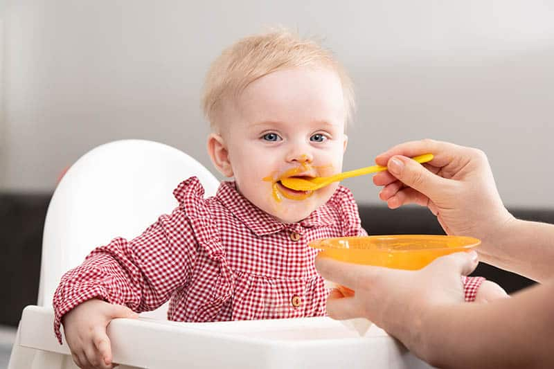 baby eating with self feeding spoon