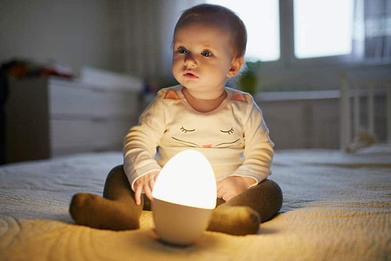 cute baby with yellow baby night light