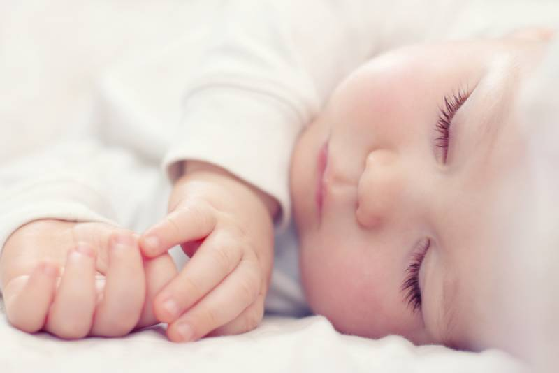 beautiful sleeping baby on white