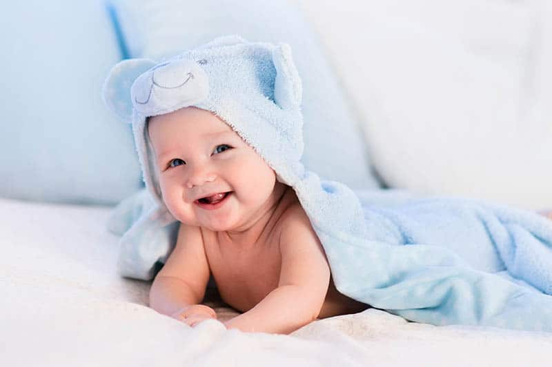 cute baby smile in blue towel