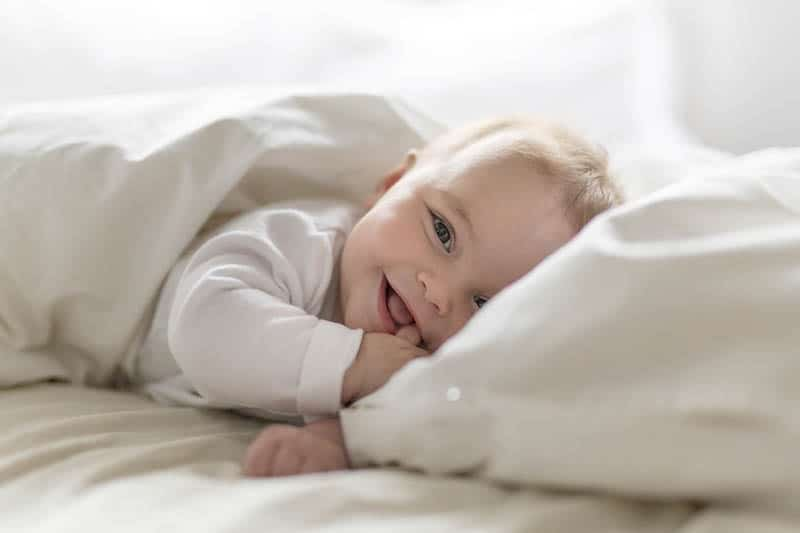 baby laughter in bed