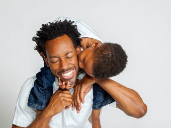 african american father dad and his son
